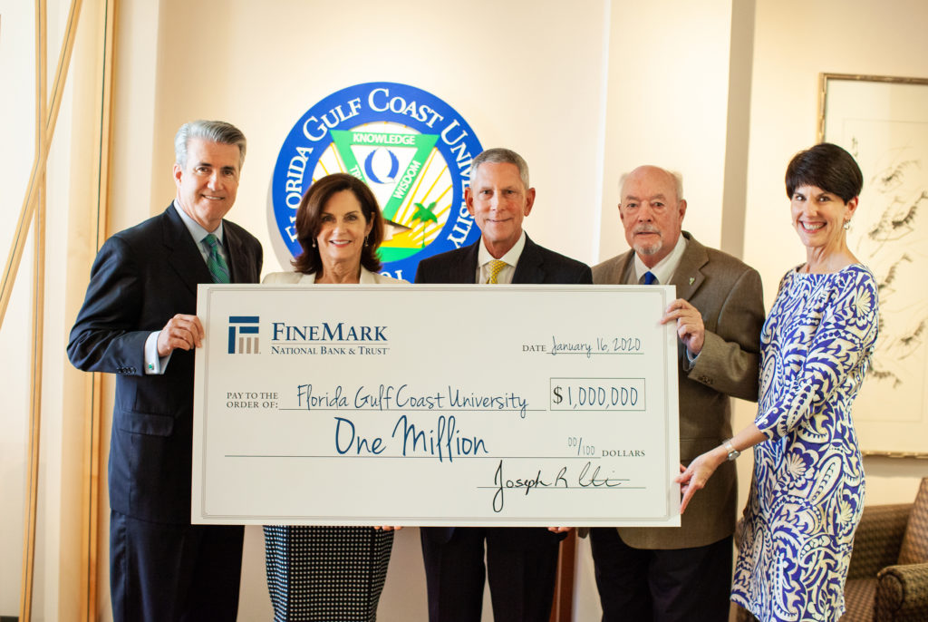 FineMark's Harlan Parrish, left, Adria Starkey and Joseph Catti join FGCU President Mike Martin and Vice President for University Advancement Kitty Green in celebrating the $1 million gift.